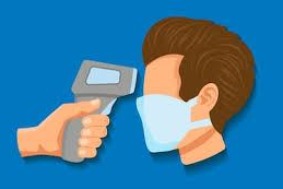 Man with face mask is screened with a temperature gun.